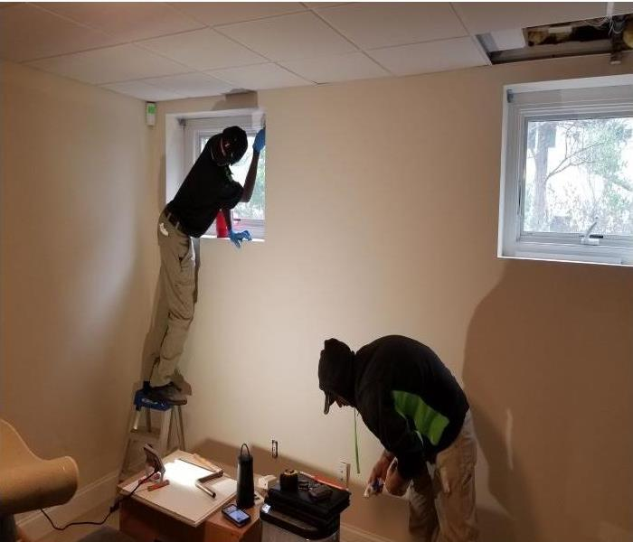 SERVPRO®  technicians painting a room